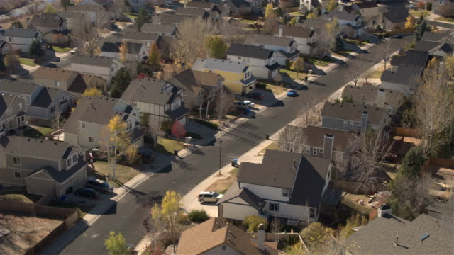 AERIAL, CLOSE UP: Suburban village with expensive row houses on sunny fall day video