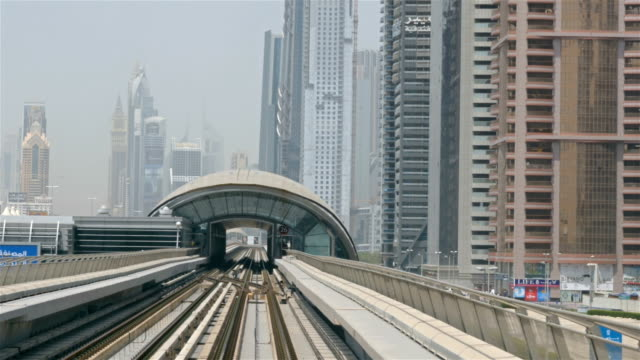 Subway in Dubai Skyscrapers downtown near Sheikh Zayed road. Travel tourism business in United Arab Emirates video