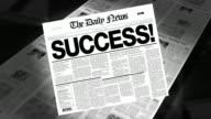 Success! - Newspaper Headline (Reveal + Loops) video