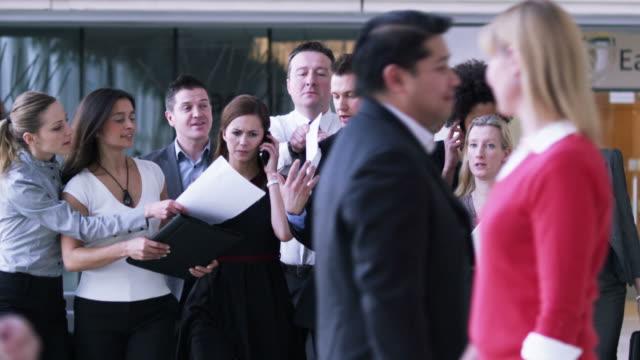 Successful businessman and entourage video