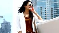 Successful businesswoman talking on phone in Dubai video