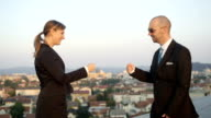 CLOSE UP: Successful co-workers bumping fist at work when achieving the deal video