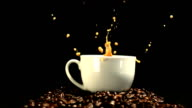 Sugar cube falling in coffee cup and splashing video