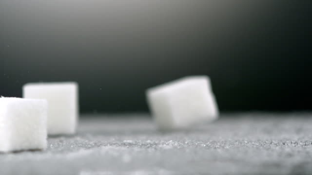 Sugar cube falling, Slow Motion video