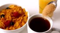 Sugar pouring into mug at breakfast table video
