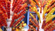 sugarcoated fruits on stick 4k video