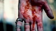 Suicidal man cutting veins, blood running down person's hand, clenching video