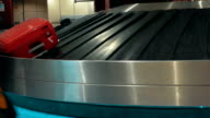 Suitcases on conveyor belt waiting for owners video