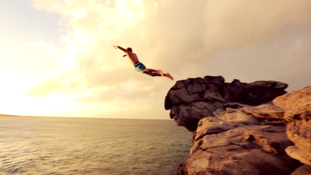 Summer Extreme Sports Cliff Jumping Outdoor Lifestyle. Cliff Jumping at Sunset. video