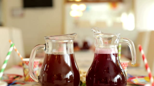 Summer fresh drinks in pitchers served on table. video