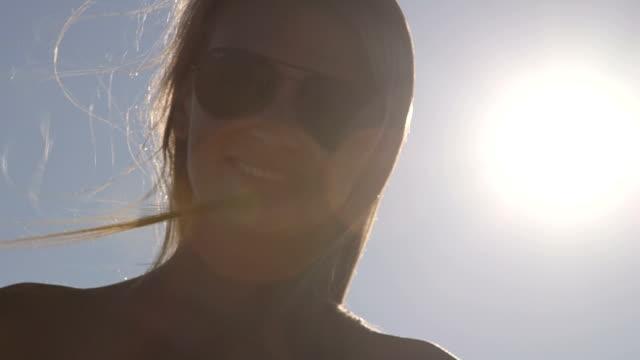 Summer girl face in the sun video