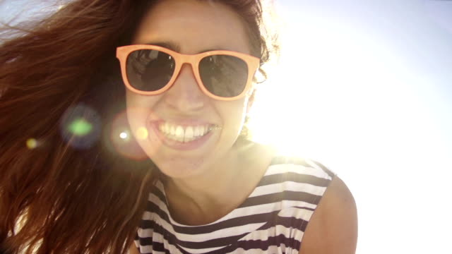 Summer girl laughing on the beach in slow motion video