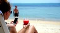 Summer Girl with Smartphone on Beach Sun Lounger video