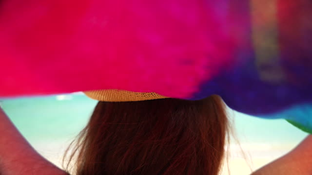 4K: Summer holiday fashion concept - Young women with a colourful scarf. video