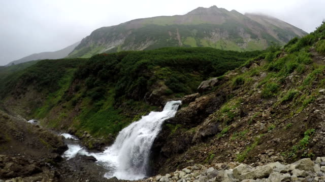 Summer mountain landscape: top view of picturesque waterfall video