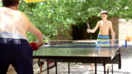 Summer vacation recreation activity boys playing table tennis game outdoor video