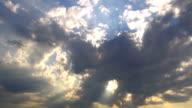 Sun beam through black cloud video