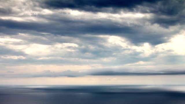 Sun beams over sea time lapse video