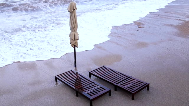 Sun beds and umbrellas on the beach. Montenegrin beaches of the video