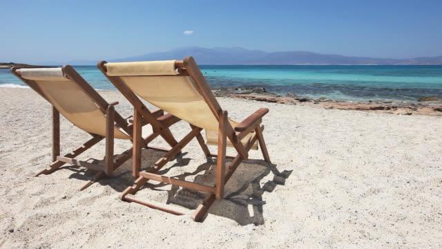 HD: Sun chairs on sandy beach video