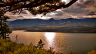 Sun, fir tree, river and mountain video