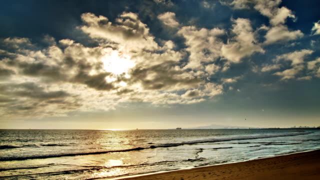 Sun in cloud and sea video
