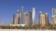 sun light day time dubai marina famous buildings beach panorama 4k uae video