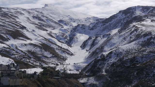 sun light day time spain ski resort pistes  sierra nevada 4k video