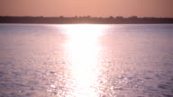 Sun path or way of light on water surface video