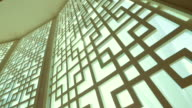 Sun rays breaking through the openwork grille on the window. video