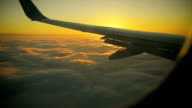 Sun Rises from Behind the Wing of the Aircraft at Sunrise view from the Window video