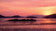 Sun Setting Behind Mountains around with water and tree landscape video