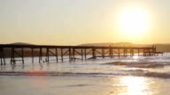 Sun Setting over Ocean Pier Background HD video