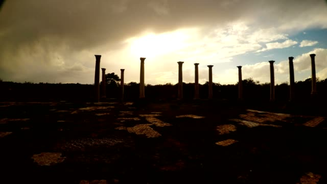 Sun shines through clouds on Colonnade of Roman Agora antique town Salamis Famagusta video