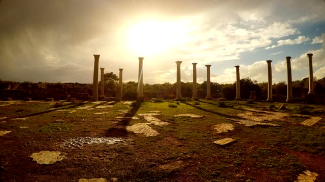 Sun shines through clouds on Colonnade of Roman Agora blue sky antique town Salamis Famagusta video