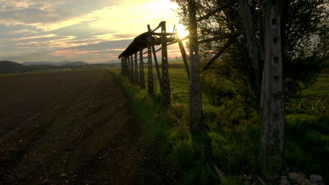 AERIAL: Sun shining through old hayrack video