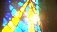 Sun shining through stained glass window video