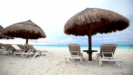 Sun umbrellas and beds on caribbean beach video