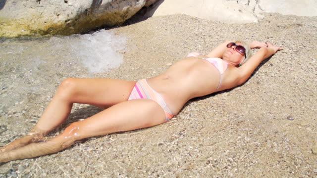 HD SUPER SLOW MO: Sunbathing On The Beach video