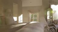 Sunbeam shining into luxury bedroom video