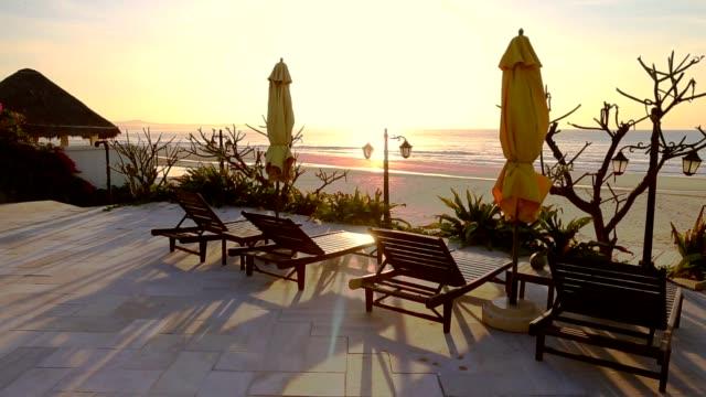 Sunbeds and umbrellas at resort sunny day tripod still. video