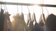 Sunlight between hangers for clothes. Solar Design Studio video