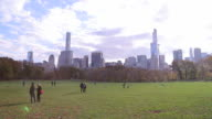 Sunlight coming out in New York City's Central Park's Great Lawn in Fall video