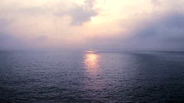 Sunlight Reflecting off Pretty Ocean ripple with Beautiful Clouds in blue Sky video
