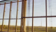Sunlight Shines Through the Bars of the Fence Dividing Mexico and America video