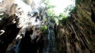 Sunlight  shining over cliff inside Batu Caves video