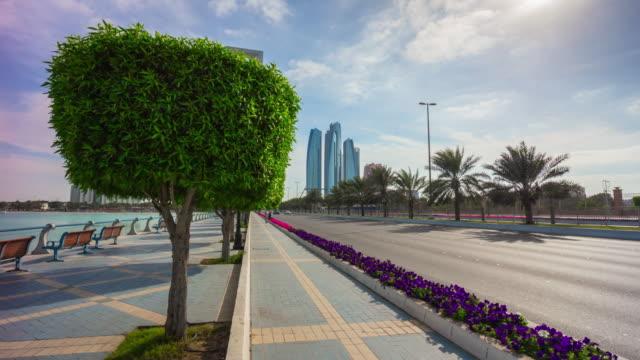 sunny abu dhabi traffic road emirates towers corniche bike track panorama 4k time lapse uae video