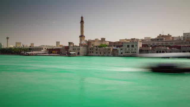 sunny day dubai city deira part bay roof top panorama 4k time lapse united arab emirates video