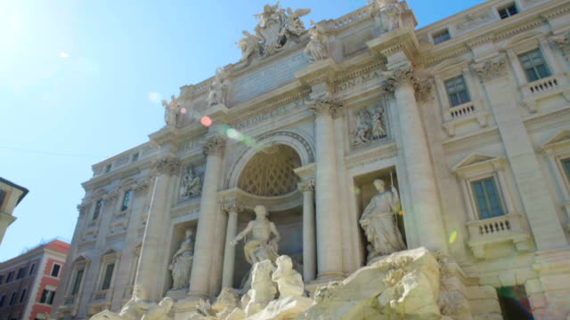 Sunny day in Rome, antique architecture of Trevi fountain, touristic sight video