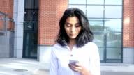 Sunny Day, Walking Girl Using Smartphone video